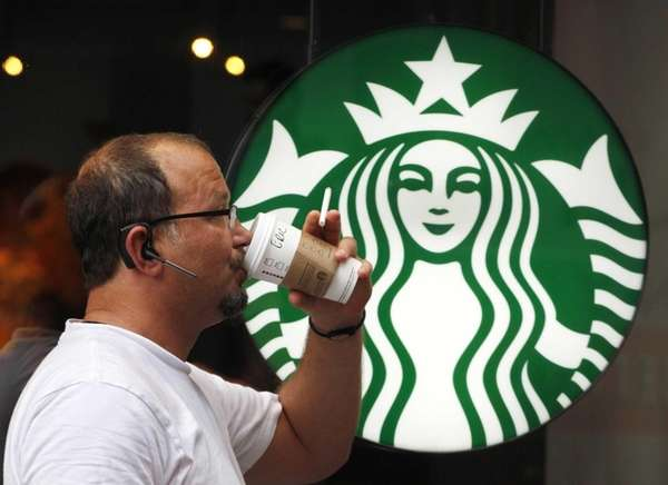A Starbucks customer enjoys his beverage in Manhattan
