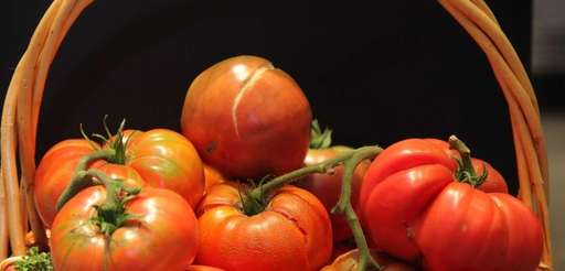A basket of tomatoes on display at the