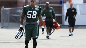 Jets' Jason Babin (58) walks to practice at