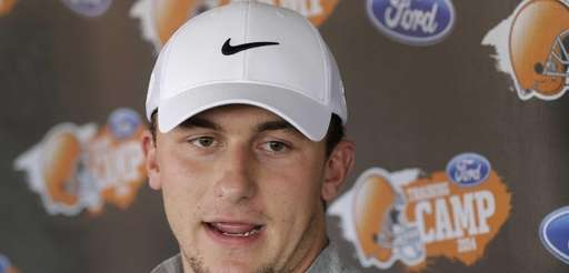 Cleveland Browns quarterback Johnny Manziel talks to reporters