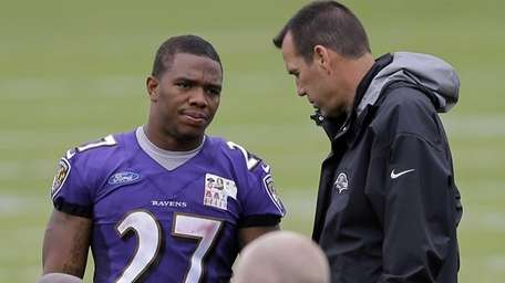 Baltimore Ravens running back Ray Rice, left, speaks