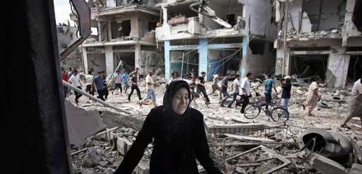 A Palestinian woman reacts after seeing her destroyed