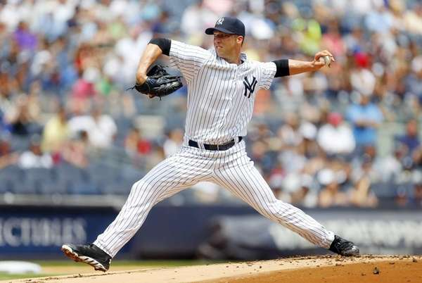 Chris Capuano of the Yankees pitches in the