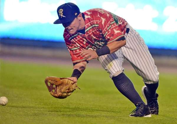 Scranton/Wilkes-Barre RailRiders' Taylor Dugas scoops up a ground