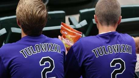 Fans wear shirts emblazoned with the misspelled surname