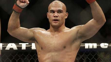 Robbie Lawler celebrates after the end of the