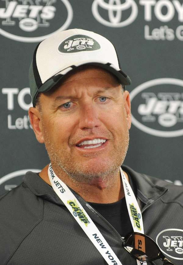 Jets head coach Rex Ryan talks to reporters
