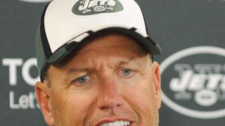 Jets head coach Rex Ryan talks to reporters