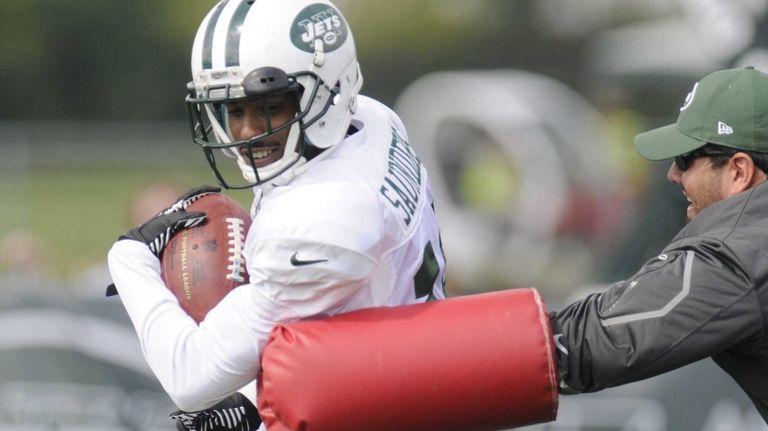 Jets wide receiver Jalen Saunders runs a drill
