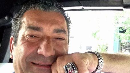 Luigi Militello shows off the 2013 Red Sox