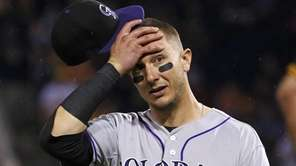 Colorado Rockies shortstop Troy Tulowitzki reacts to the