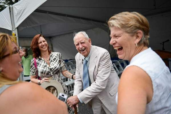 Richard Hendrickson, 101, of Bridgehampton, laughs while standing