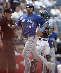 Toronto Blue Jays rightfielder Jose Bautista (19) scores
