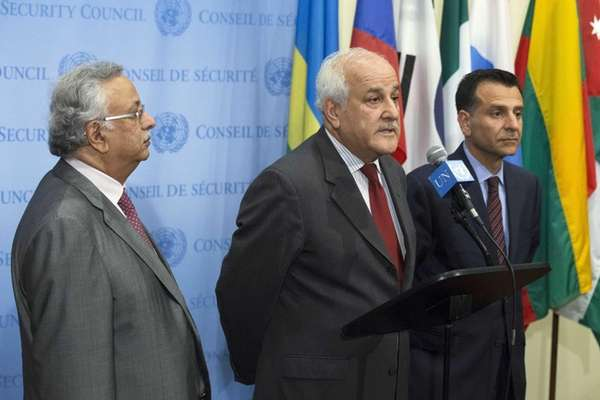 Palestinian U.N. Ambassador Riyad Mansour, center, speaks following