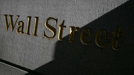 Despite two good-sized company deals, stocks were down