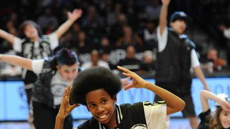 Mario Braxton, 11, of Shirley, performs as part