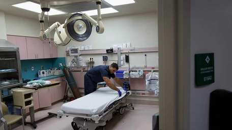 Paramedic prepares a room for the next patient