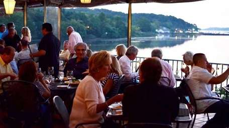 Diners enjoy food and drinks with a view