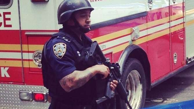 An NYPD officer stands guard on West Fourth