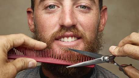 Tennis pro Christian Guevara gets his beard trimmed