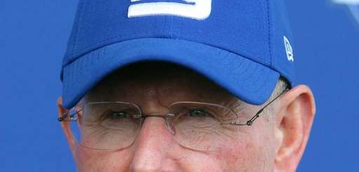 Giants head coach Tom Coughlin speaks to the