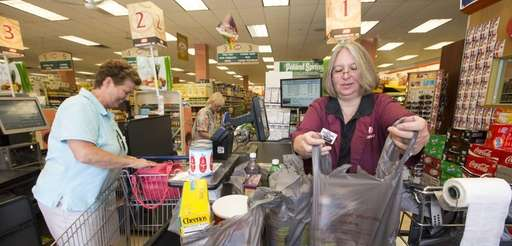 Susan Fisher, a cashier at the IGA in