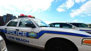 Long Beach Police cars outside their headquarters on