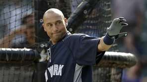 The Yankees' Derek Jeter acknowledges fans as they