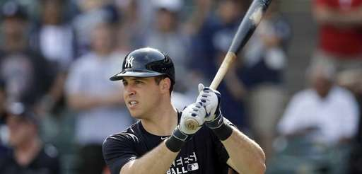 The Yankees' Mark Teixeira takes practice swings as