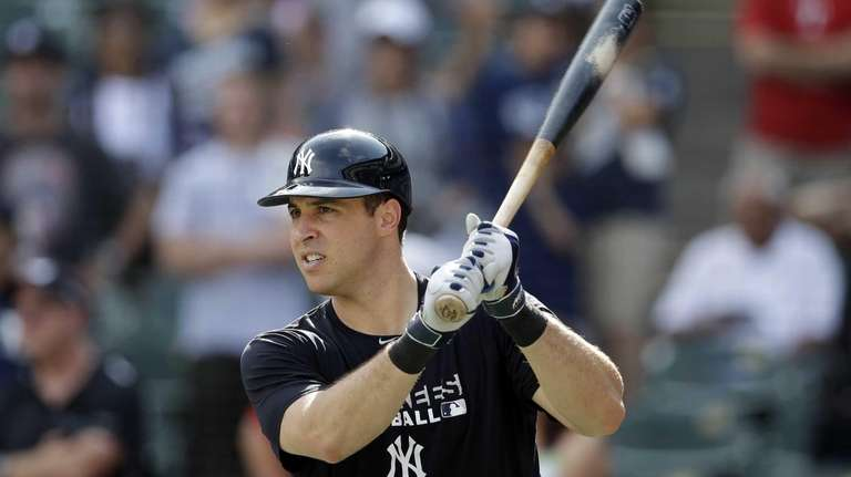 The Yankees' Mark Teixeira takes practice swings as
