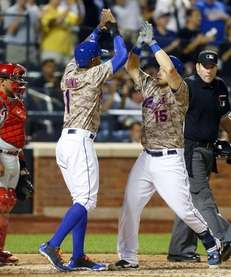 Travis d'Arnaud of the Mets celebrates his fifth-inning,