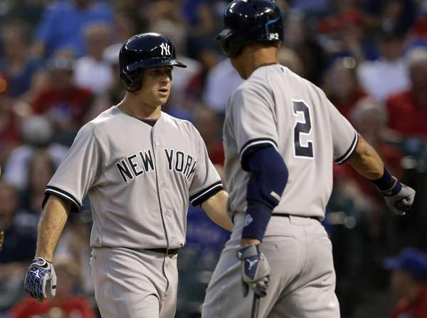 Yankees' Brett Gardner, left, is congratulated by Derek
