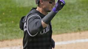 Colorado Rockies' Troy Tulowitzki celebrates his second home