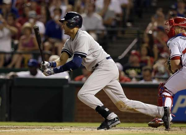The Yankees' Derek Jeter follows through on a