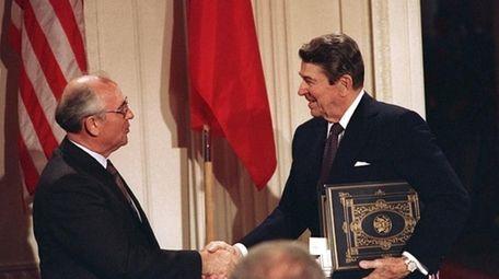 In this file photo, U.S. President Ronald Reagan,