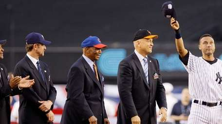 Derek Jeter, right, stands next to Hall of
