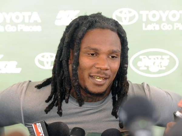 Jets running back Chris Johnson talks to reporters