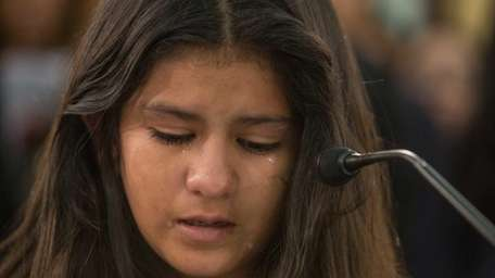 Mayeli Hernandez, 12, from Honduras, cries as she