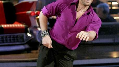 Maksim Chmerkovskiy performs on the celebrity dance competition
