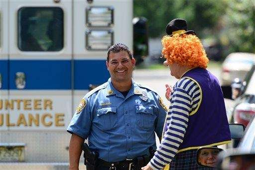 Westwood Police Officer Niko Pieratos talks with Jack
