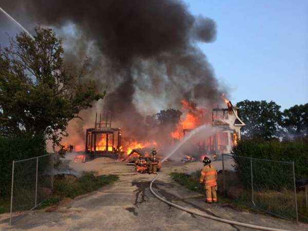 Emergency personnel respond to a structure fire on