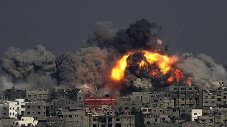 Smoke rises from the Tuffah neighborhood after Israeli