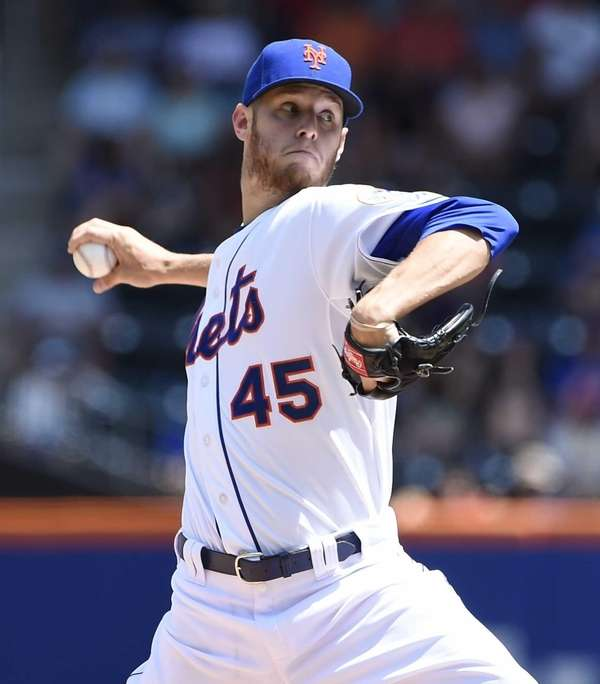 The Mets starting pitcher Zack Wheeler delivers a