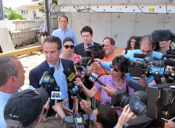 New York Gov. Andrew Cuomo, center left, is