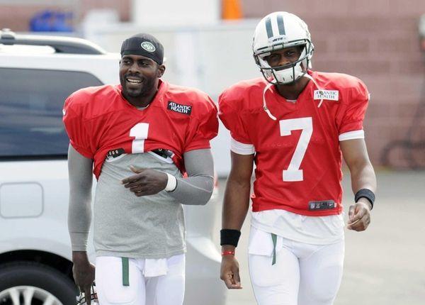 Jets quarterbacks Michael Vick and Geno Smith walk