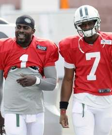 Jets quarterbacks Michael Vick and Geno Smith walk