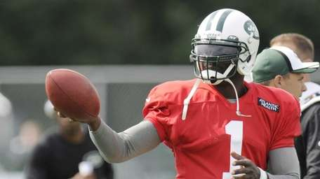 Jets quarterback Michael Vick gestures during training camp