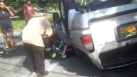 Emergency personnel respond to a two-vehicle accident involving