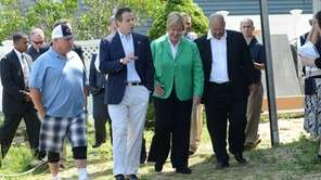 Homeowner of Dan Ehrick, left, walks on July