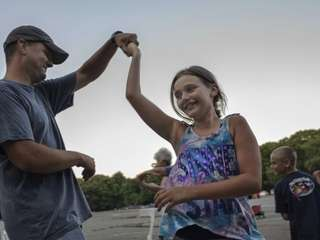 Rose Peterson, 11, of Patchogue, square dances with
